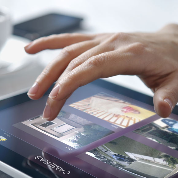 Hand using tablet device