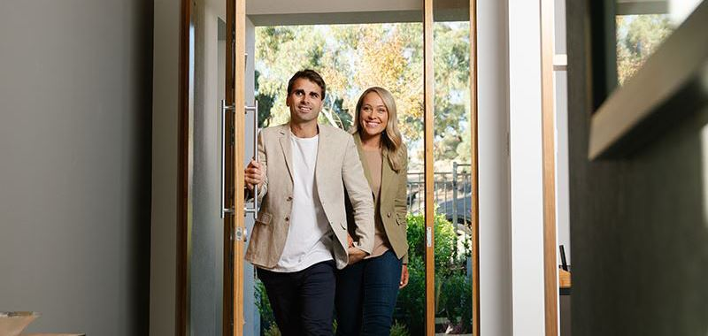 Couple entering house