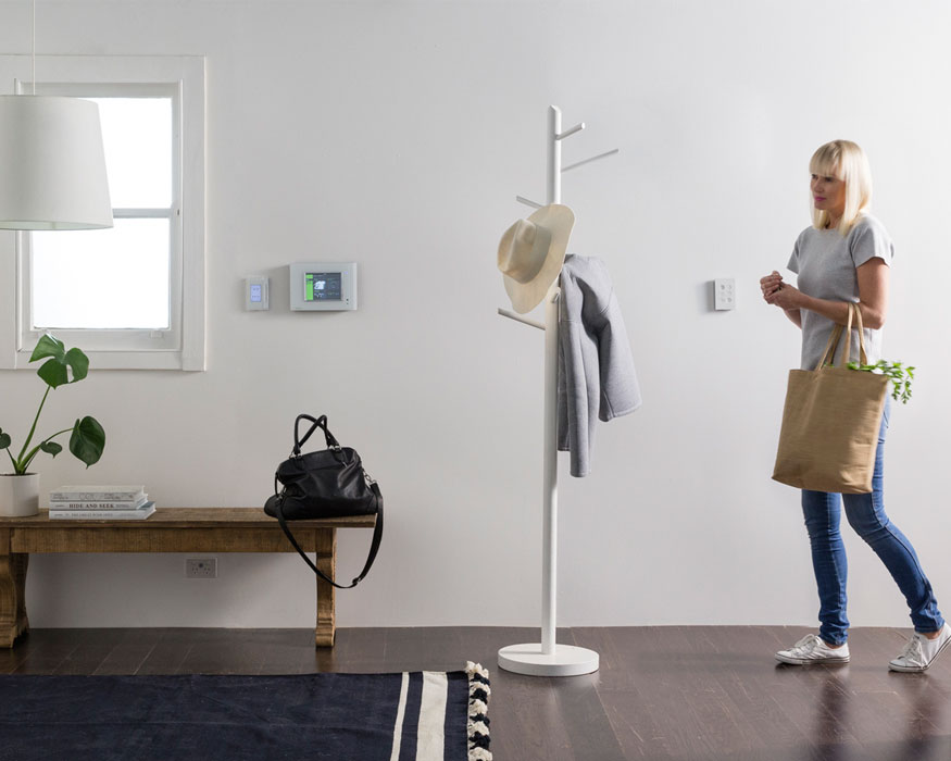 Woman entering modern home