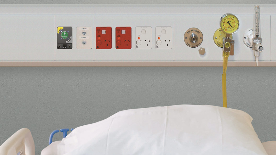 Hospital bed with Clipsal products above it.