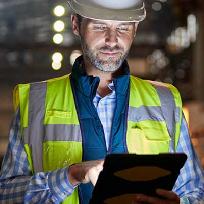 Tradesman looking at Tablet Device