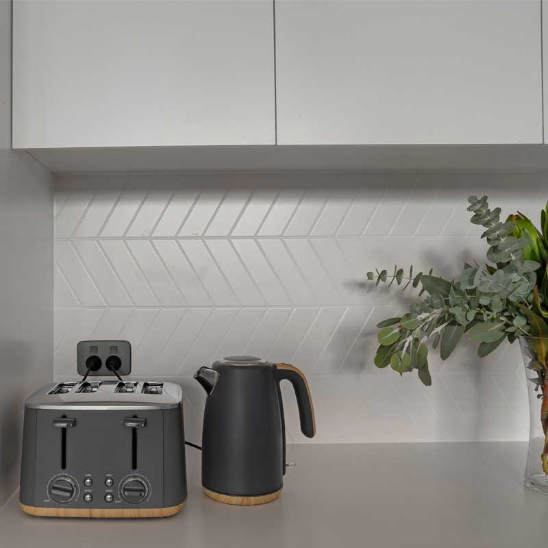 Clipsal Iconic Essence Anthracite in stylish kitchen.