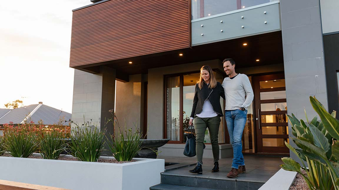 Couple walking out of smart home