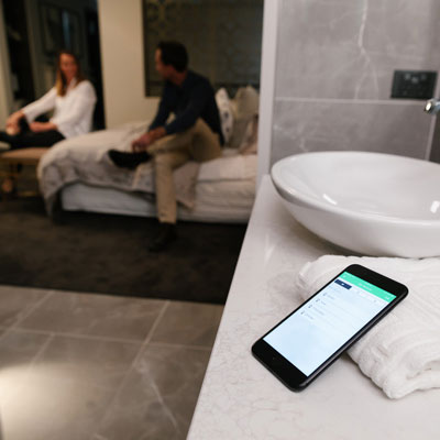 The Wiser Room mobile app in a family bathroom.